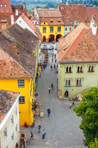 SIGHISOARA, ROMANIA - JULY 17: Aerial view of Old Town in Sighisoara, major tourist attraction on July 17, 2014. City in which was born Vlad Tepes, Dracula