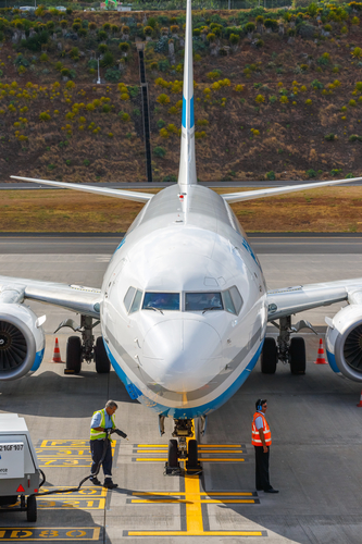 Funchal, Madeira - July 6, 2016: Enter Air Boeing 737 at Funchal Cristiano Ronaldo Airport, boarding passengers.This airport is one of the most dangerous airports in Europe