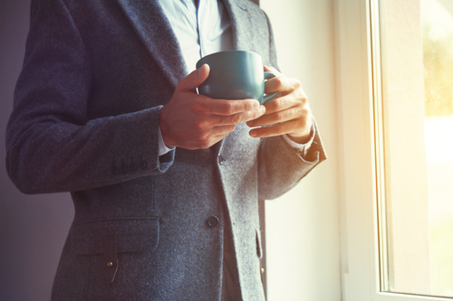 businessman hand holding morning tea or coffee